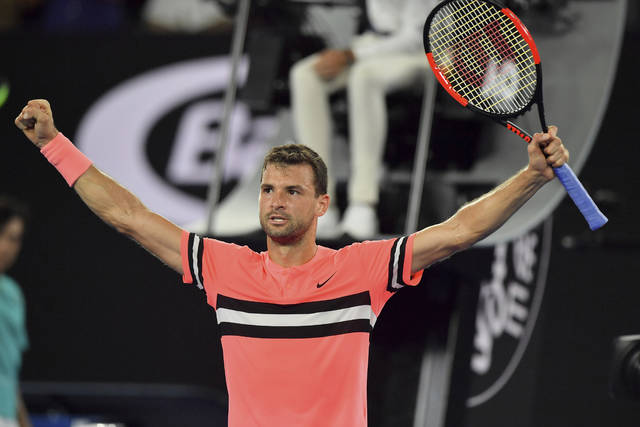 Bulgaria's Grigor Dimitrov celebrates after defeating United States' Mackenzie McDonald in their second round match at the Australian Open tennis championships in Melbourne, Australia, Wednesday, Jan. 17, 2018. (AP Photo/Andy Brownbill)