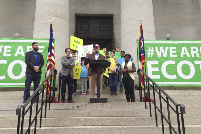 FILE – In this May 9, 2017, file photo, Bill Lager, center, co-founder of Ohio's largest online charter school, the Electronic Classroom of Tomorrow or ECOT, speaks to hundreds of supporters during a rally outside the Statehouse in Columbus, Ohio. The virtual school could lose its required sponsor and abruptly close in early 2018, although ECOT has said it's working to remain open. Wednesday, Jan. 17, 2018, is the school's deadline to send a proposed remedy to the sponsor, Educational Service Center of Lake Erie West. (AP Photo/Julie Carr Smyth, File)