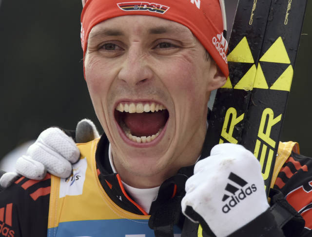 FILE - In this March 19, 2017, file photo, Eric Frenzel of Germany celebrates his victory in the overall World Cup at the Nordic Combined World Cup in Schonach, Germany. With five World Cup titles and an Olympic gold medal, Frenzel goes into the 2018 Pyeongchang Games as the man to beat in Nordic combined. (Patrick Seeger/dpa via AP, File)