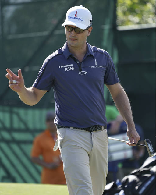 FILE - In this Jan. 11, 2018, file photo, Zach Johnson waves to the gallery off the eight green during the first round of the Sony Open golf tournament in Honolulu.  Johnson is optimistic about ending his two-year drought without a victory. (AP Photo/Marco Garcia, File)