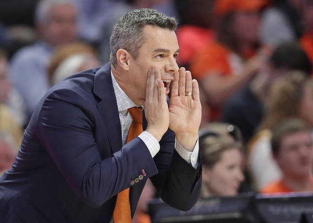 Virginia head coach Tony Bennett directs his team against Wake Forest during the first half of an NCAA basketball game in Winston-Salem, N.C., Sunday, Jan. 21, 2018. (AP Photo/Chuck Burton)