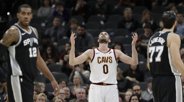 Cleveland Cavaliers forward Kevin Love (0) reacts after he was called for a personal foul against San Antonio Spurs forward LaMarcus Aldridge (12) during the first half of an NBA basketball game, Tuesday, Jan. 23, 2018, in San Antonio. (AP Photo/Eric Gay)