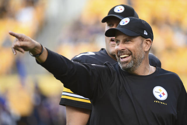 FILE - This Aug. 26, 2017 file photo shows Pittsburgh Steelers offensive coordinator Todd Haley standing with quarterback Ben Roethlisberger (7) before an NFL preseason football game against the Indianapolis Colts in Pittsburgh. A person familiar with the negotiations says the Browns are hiring Todd Haley. Cleveland coach Hue Jackson is turning his offense over to Haley, who spent six seasons in Pittsburgh before he was fired last week, said the person who spoke Monday, Jan. 22, 2018 to the Associated Press on condition of anonymity because the team has not announced the move. (AP Photo/Fred Vuich, file)