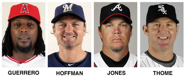 FILE - These file photos show baseball players, from left, Vladimir Guerrero, Trevor Hoffman, Chipper Jones and Jim Thome. All four were elected to baseball's Hall of Fame on Wednesday, Jan. 24, 2018.  (AP Photo/File)