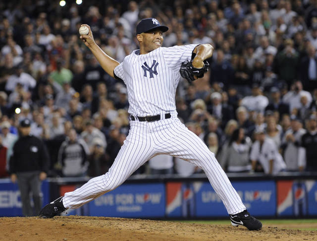 FILE - In this Sept. 26, 2013, file photo, New York Yankees reliever Mariano Rivera throws to a Tampa Bay Rays batter during the eighth inning of a baseball game at Yankee Stadium in New York. Rivera was making his final appearance at home for the Yankees. It could be another crowded Hall of Fame ceremony in 2019. After four players were voted in this year by the BBWAA, Rivera and Roy Halladay headline next year's ballot. (AP Photo/Bill Kostroun, File)