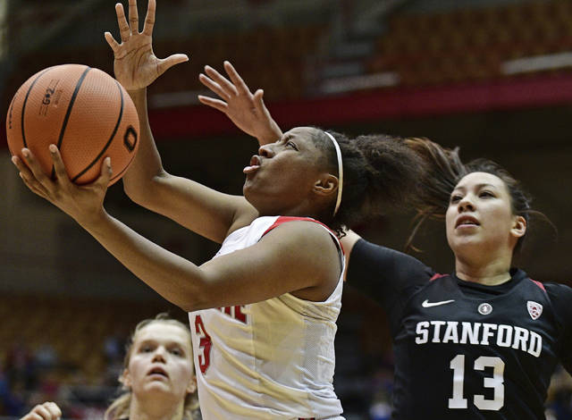 FILE - In this Nov. 10, 2017, file photo, Ohio State's Kelsey Mitchell, front left, drives to the basket on Stanford's Marta Sniezek, right, during the fourth quarter of an NCAA college basketball game in Columbus, Ohio. Mitchell became the Big Ten's all-time scoring leader this weekend against Michigan State, passing Minnesota's Rachel Banham who scored 3,093 points. (AP Photo/David Dermer, File)