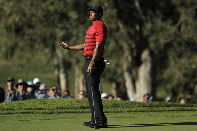 Tiger Woods reacts after missing a putt on the 13th hole of the South Course at Torrey Pines Golf Course during the final round of the Farmers Insurance Open golf tournament, Sunday, Jan. 28, 2018, in San Diego. (AP Photo/Gregory Bull)
