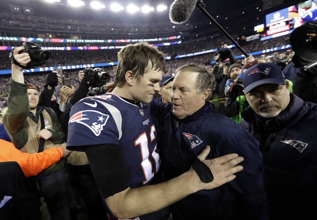 FILE - In this Jan. 21, 2018, file photo, New England Patriots quarterback Tom Brady, left, hugs coach Bill Belichick after the AFC championship NFL football game against the Jacksonville Jaguars in Foxborough, Mass. Opponents tend to freak out against Brady and Belichick just when they're about to conquer the New England Patriots' dynastic duo. The Philadelphia Eagles swear they won't fall into that trap if they have the chance in Super Bowl 52. (AP Photo/David J. Phillip, File)