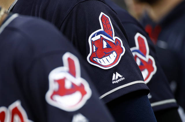 FILE - In this June 19, 2017 file photo, members of the Cleveland Indians wear uniforms featuring mascot Chief Wahoo as they stand on the field for the national anthem before a baseball game against the Baltimore Orioles in Baltimore. The Cleveland Indians are taking the divisive Chief Wahoo logo off their jerseys and caps, starting in 2019.  (AP Photo/Patrick Semansky, File)