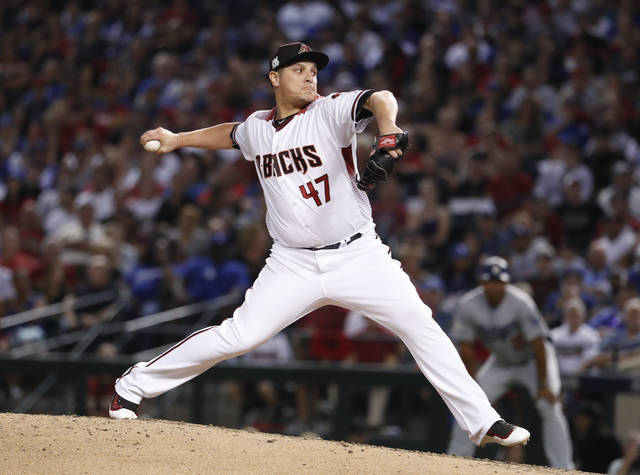 FILE - In this Oct. 9, 2017, file photo, Arizona Diamondbacks relief pitcher David Hernandez (47) throws during the second inning of Game 3 of baseball's National League Division Series against the Los Angeles Dodgers in Phoenix. Hernandez has agreed to a $5 million, two-year contract with the Cincinnati Reds, adding another late-inning option to a bullpen that's been a top offseason priority. The 32-year-old right-hander will make $2.5 million annually under the deal announced Tuesday, Jan. 30, 2018. He can earn another $1 million each year in performance bonuses. (AP Photo/Rick Scuteri, File)