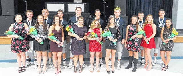 Kayla Gregg was crowned queen and Jordan Stroud king Saturday night at the Blanchester High School winter homecoming. In the photo, from left to right, front row, Jade West, Shelbie Rose, Erin Wilson, Lilly Tedrick, Hayley Wilson, queen Kayla Gregg, 2017 queen Shayla Sicurella, Brianna Wilson, Noelani Tangonan; back row, Tanner Creager, Noah Armocida, Wesley Mitchell, Jake Fischer, Lane Heeg, king Jordan Stroud, Ian Heeg, Brayden Sipple.