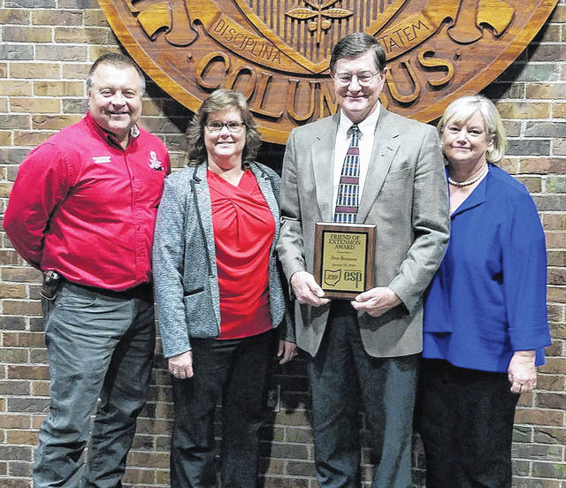 From left, ANR Educator David Dugan, County Extension Director and 4-H Educator Kathy Bruynis, Don and Chris Branson.
