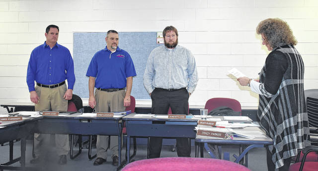 From left, Andy Avery, Michael Goodall and Jeremy Lamb are sworn in as Clinton-Massie school board members by Treasurer Tracy Parker during Tuesday night's meeting. Lamb was appointed Board President with fellow member Christopher Harrison appointed Vice President.