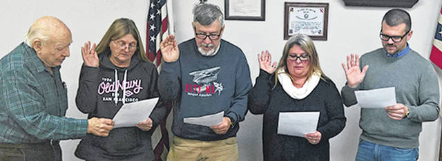 At the Dec. 28 session of Sabina Village Council, Sabina Mayor Dean Hawk swore in council members who were newly elected or re-elected to start terms in January. From left are Mayor Dean Hawk, Councilwoman Peggy Slone, Councilman Robert Storer, Councilwoman Vicki Mongold and Councilman Michael Bishop. Mongold and Bishop are new to the village's legislative body. Also on council are Jim Mongold and Mike Walls. Sabina Village Council meetings are held on the second and fourth Thursdays of each month, starting at 7 p.m. in council chambers at the Sabina Municipal Building. Meetings are open to all, and the public is encouraged to attend.