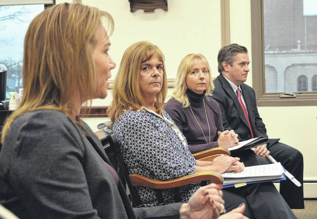 From left are Clinton County Jobs and Family Services (JFS) Deputy Director Gina Speaks-Eshler, Child Protection Unit Fiscal Administrator Cheryl Babb, Clinton County JFS Director Kathi Spirk and Assistant Clinton County Prosecuting Attorney Andrew McCoy.