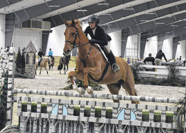 """Calli Best and her horse Lord Stanley leap over the obstacles in the $300 Performance Hunter 3' 3"""" class at the World Equestrian Center Winter Classic #3 on Thursday. The venue has weekly equestrian events booked every week through the spring."""