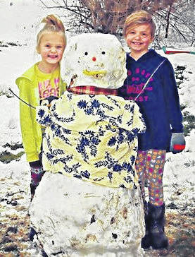 Heidi and Shelby Newton of Wilmington took advantage of the snow still on the ground over the weekend to make this colorful character.