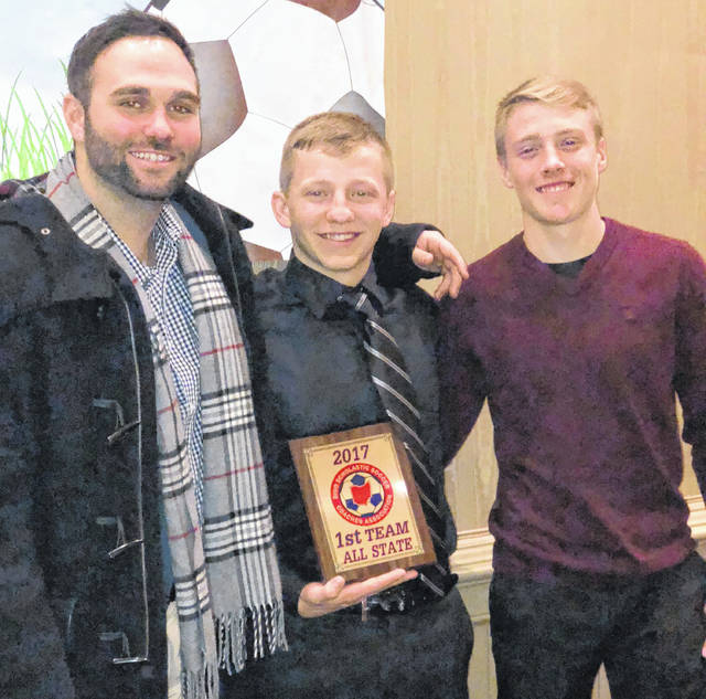 Wilmington High School senior Sam Spirk received his first team All-Ohio plaque Saturday from the Ohio Scholastic Soccer Coaches Association. Spirk, WHS assistant coach Luca Terrigno and Spirk's classmate and teammate Seth Gundlach were present for the event. Spirk posted a school record 117 goals and 61 assists in his WHS career. In addition to his 37 goals this season, Spirk scored 35 as a junior, 35 as a sophomore and 10 as a freshman. He had 9 assists this season, 23 as a junior, 17 as a sophomore and 12 as a freshman. The 117 career goals lands Spirk in the unofficial OHSAA record book. He is tied for 22nd all time with two other players. The state's all-time career leader is Calum Latham of Catholic Central, who scored 198 goals from 2008-2011.
