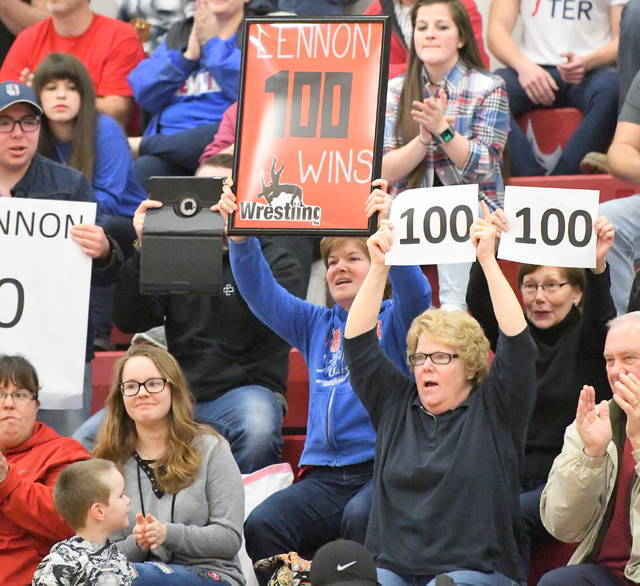 Ross Lennon's family and friends celebrate his 100th win Thursday night.