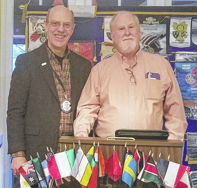 AM Rotary guest Dennis Mattingly, right, with Rotary President Chuck Watts.