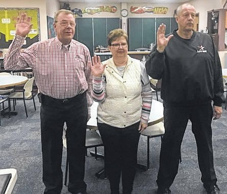 Individuals elected in November to the East Clinton Local Schools Board of Education were sworn in this week. From left are Dr. Robert Carey, Linda Compton and Tim Starkey. Compton and Starkey were incumbents and were re-elected to their board seats, while Carey served on the East Clinton school board in the past and has now returned as a board member after a number of years. The other two board members are Mark Garen and Greg Bronner.