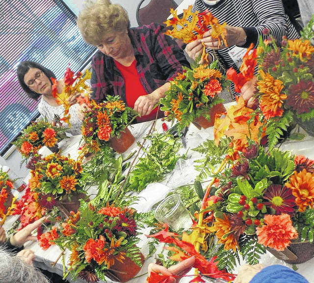 The Wilmington Garden Club had a busy late fall sharing holiday themes and arranging tips at a meeting and a Christmas Tea.