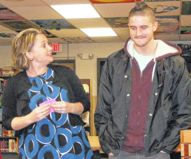"""Wilmington High School Principal Stephanie N. Walker, left, recognizes student Riley Brown, right, who about two weeks ago asked her whether he could place on every locker in the building Post-it notes with positive motivating statements on them. The notes can result in """"a positive vibe"""" for the recipient, said Walker, who described the activity as bringing """"trickles of positivity"""" among students and teachers (who got notes, too). The principal estimates there are 900 lockers at WHS. Brown is """"a jokester"""" in general and """"an amazing kid,"""" said Walker."""