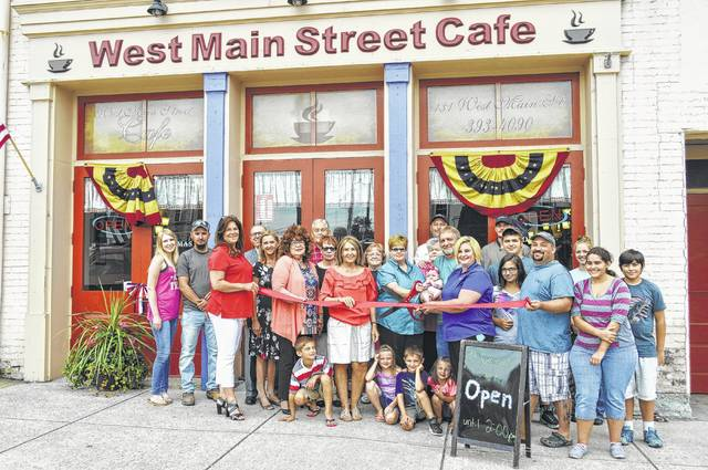 "Shown are participants in a ribbon-cutting ceremony last summer celebrating the opening of Momma's West Main Street Cafe in Hillsboro. The restaurant will be hosting ""Fox & Friends"" on Jan. 17."