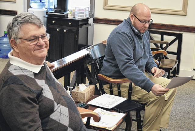 From left, Blanchester Village Councilman Don Gephart and Clinton County Solid Waste District Coordinator Jeff Walls give details on a proposal for curbside recycling in Blanchester.