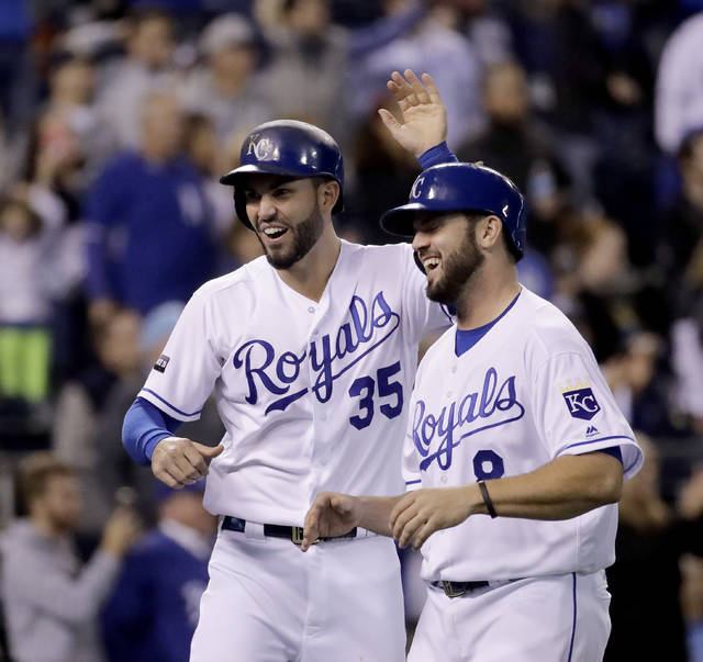 FILE - In this Sept. 27, 2017, file photo, Kansas City Royals' Eric Hosmer (35) and Mike Moustakas (8) celebrate after they scored on a double by Alcides Escobar during the eighth inning of a baseball game against the Detroit Tigers in Kansas City, Mo. Agent Brodie Van Wagenen, co-head of CAA Baseball, said Friday, Feb. 2, 2018, that baseball players should consider boycotting spring training because of the slow free-agent market. J.D. Martinez, Eric Hosmer, Mike Moustakas, Jake Arrieta, Alex Cobb, Greg Holland and Lance Lynn remain among the dozens of unsigned players with the Feb. 14 start of spring training less than two weeks away. (AP Photo/Charlie Riedel, File)