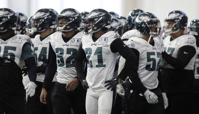 FILE - In this Thursday, Feb. 1, 2018, file photo, Philadelphia Eagles cornerback Patrick Robinson (21) and teammates break a huddle during a practice for the NFL Super Bowl 52 football game in Minneapolis. Philadelphia is scheduled to face the New England Patriots in the game on Sunday. You can watch the Super Bowl online for free, and it'll be easier to do so as phone viewing is no longer limited to Verizon customers. (AP Photo/Eric Gay, File)