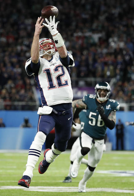 New England Patriots quarterback Tom Brady can't catch a pass on a flea flicker during the first half of the NFL Super Bowl 52 football game against the Philadelphia Eagles Sunday, Feb. 4, 2018, in Minneapolis. (AP Photo/Matt York)