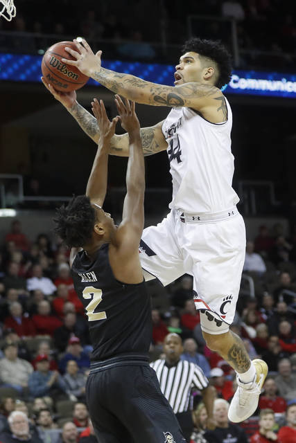 Cincinnati's Jarron Cumberland (34) shoots against Central Florida's Terrell Allen (2) in the first half of an NCAA college basketball game, Tuesday, Feb. 6, 2018, in Highland Heights, Ky. (AP Photo/John Minchillo)