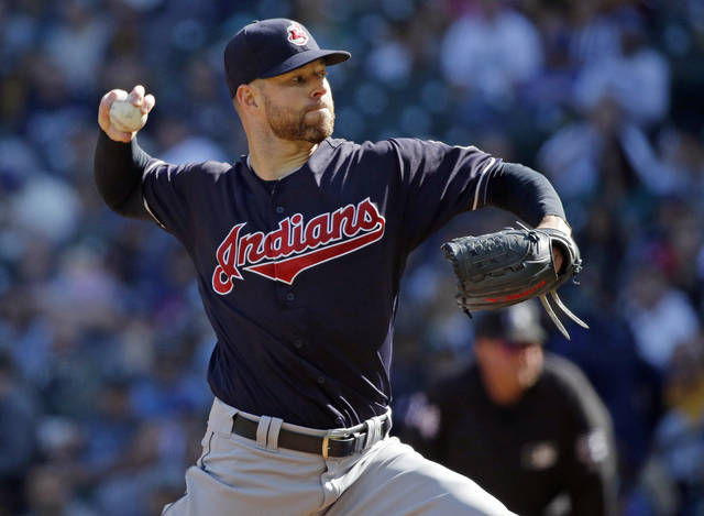 FILE - In this Sept. 24, 2017, file photo, Cleveland Indians starting pitcher Corey Kluber throws against the Seattle Mariners during the first inning of a baseball game in Seattle. Determined to end their World Series title drought in 2017 after coming so close the previous season, the AL Central champions were bounced in the playoffs by the New York Yankees despite taking a 2-0 series lead. It was a bitter finish for a team that won 102 games and reeled off 22 straight victories. But while there was a sense of finality for some Cleveland fans, manager Terry Francona said these Indians aren't done. (AP Photo/Ted S. Warren, File)