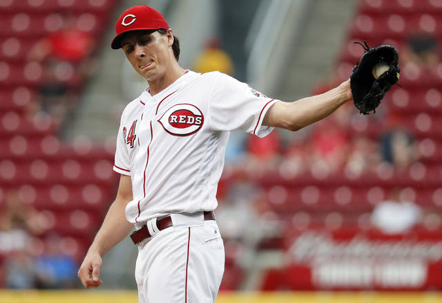 FILE - In this Sept. 21, 2017, file photo, Cincinnati Reds starting pitcher Homer Bailey reacts after walking St. Louis Cardinals' Yadier Molina during the first inning of a baseball game in Cincinnati. The Reds' rotation didn't even make it into spring training last year before it got scrambled by injury. Homer Bailey needed elbow surgery before camp even opened, and it just got worse as it went along.  (AP Photo/John Minchillo, File)