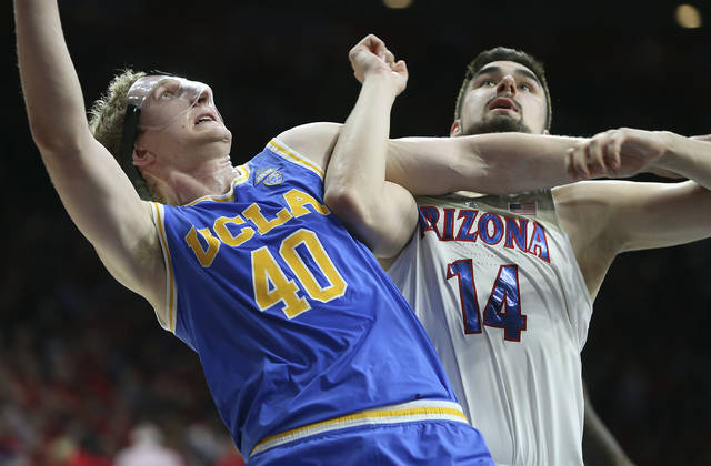 UCLA center Thomas Welsh (40) and Arizona's Dusan Ristic (14) wait for a rebound during the second half of an NCAA college basketball game Thursday, Feb. 8, 2018, in Tucson, Ariz. UCLA defeated Arizona 82-74. (AP Photo/Ralph Freso)