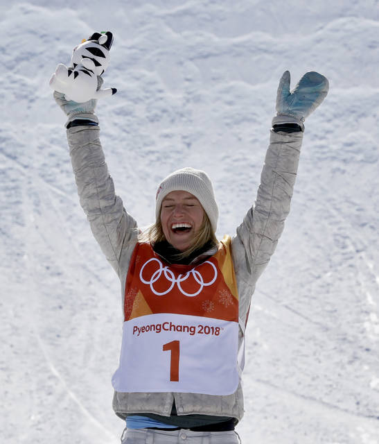 JamieAnderson, of the United States, celebrates winning gold after the women's slopestyle final at Phoenix Snow Park at the 2018 Winter Olympics in Pyeongchang, South Korea, Monday, Feb. 12, 2018. (AP Photo/Lee Jin-man)
