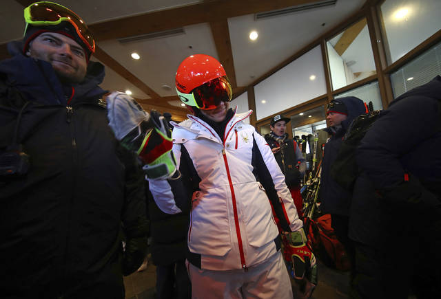 United States' Mikaela Shiffrin waves as she leaves the course after the women's giant slalom was postponed due to high winds at the 2018 Winter Olympics at the Yongpyong Alpine Center, Pyeongchang, South Korea, Monday, Feb. 12, 2018. (AP Photo/Alessandro Trovati)