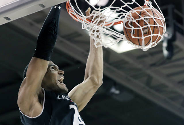 Cincinnati forward Kyle Washington (24) dunks the ball on a break away play in the first half of an NCAA college basketball game against SMU on Sunday, Feb. 11, 2018, in Dallas. (AP Photo/Tony Gutierrez)