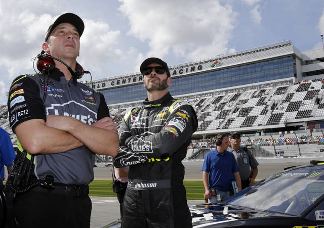Crew chief Chad Knaus, left, and Jimmie Johnson watch the leaderboard during qualifying for the NASCAR Daytona 500 auto race at Daytona International Speedway, Sunday, Feb. 11, 2018, in Daytona Beach, Fla. (AP Photo/Terry Renna)
