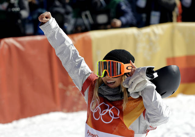 Chloe Kim, of the United States, reacts to her run during the women's halfpipe finals at Phoenix Snow Park at the 2018 Winter Olympics in Pyeongchang, South Korea, Tuesday, Feb. 13, 2018. (AP Photo/Lee Jin-man)