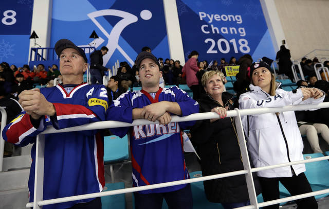 From left, Greg Brandt, father of Marissa Brandt, her husband Brett Ylonen, mother Robin Brandt and sister Hannah Brandt wait before the preliminary round of the women's hockey game between Japan and the combined Koreas at the 2018 Winter Olympics in Gangneung, South Korea, Wednesday, Feb. 14, 2018. (AP Photo/Frank Franklin II)
