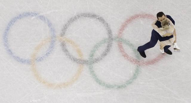 Alexa Scimeca Knierim and Chris Knierim of the USA perform in the pair figure skating short program in the Gangneung Ice Arena at the 2018 Winter Olympics in Gangneung, South Korea, Wednesday, Feb. 14, 2018. (AP Photo/Morry Gash)