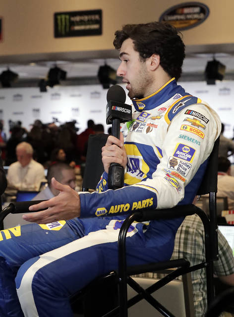 Chase Elliott takes part in an interview during media day for the NASCAR Daytona 500 auto race at Daytona International Speedway, Wednesday, Feb. 14, 2018, in Daytona Beach, Fla. (AP Photo/John Raoux)
