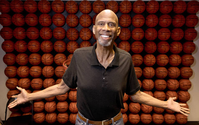 """In this Monday, Feb. 12, 2018 photo, Kareem Abdul-Jabbar poses in his office, in Newport Beach, Calif. Abdul-Jabbar has been a best-selling author, civil-rights activist, actor, historian and one of the greatest basketball players who ever lived. This fall Abdul-Jabbar will embark on a cross-country tour as part of """"Becoming Kareem,"""" a stage show in which he'll discuss his life, answer audience questions and talk about the key mentors in his life he says helped him achieve his goals along the way. (AP Photo/Mark J. Terrill)"""