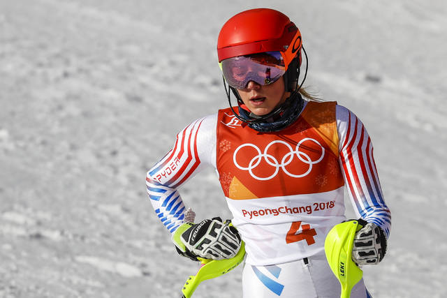 Mikaela Shiffrin, of the United States, rests in the finish area after the first run of the Women's Slalom at the 2018 Winter Olympics in Pyeongchang, South Korea, Friday, Feb. 16, 2018. (AP Photo/Morry Gash)