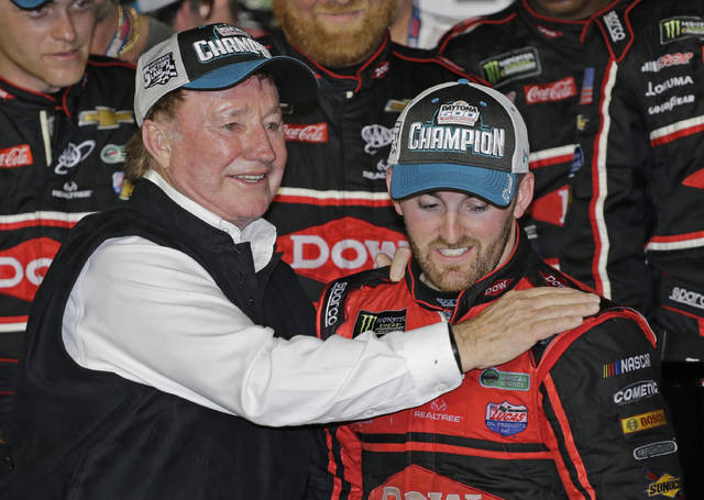 Austin Dillon, right, is congratulated by his grandfather, Richard Childress, after winning the NASCAR Daytona 500 Cup series auto race at Daytona International Speedway in Daytona Beach, Fla., Sunday, Feb. 18, 2018. (AP Photo/Terry Renna)