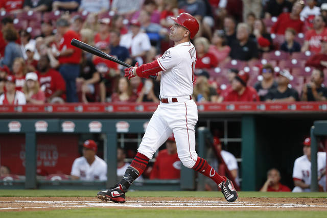 FILE - In this Sept. 15, 2017, file photo, Cincinnati Reds' Joey Votto hits a solo home run off Pittsburgh Pirates starting pitcher Chad Kuhl in the first inning of a baseball game, in Cincinnati. Votto had one of his best seasons, and Cincinnati still lost 90 games. The MVP runner-up is yearning for the time when he can contribute to a winning Reds team. (AP Photo/John Minchillo, File)