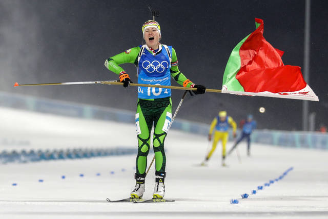 Darya Domracheva, of Belarus, skis across the finish line for the gold medal during the women's 4x6-kilometer biathlon relay at the 2018 Winter Olympics in Pyeongchang, South Korea, Thursday, Feb. 22, 2018. (AP Photo/Andrew Medichini)