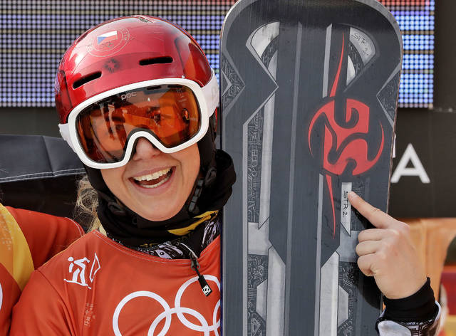 Gold medal winner Ester Ledecka, of the Czech Republic, smiles after the women's parallel giant slalom at Phoenix Snow Park at the 2018 Winter Olympics in Pyeongchang, South Korea, Saturday, Feb. 24, 2018. (AP Photo/Lee Jin-man)